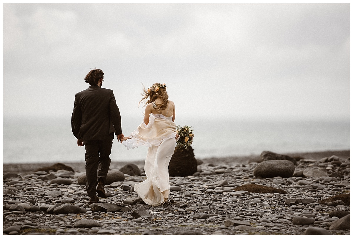 Reynisdrangar's windy rocky beach is a stunning location for any Icelandic intimate wedding or private elopement. This magical Iceland adventure elopement captured by Maddie Mae Photography.