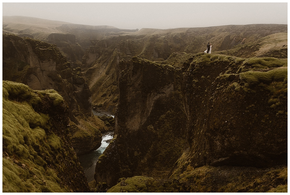 The stunning views from Fjadrargljufur Canyon put into perspective how small they were and how epic their love. Their stunning wedding photos taken by intimate wedding photographer Maddie Mae.