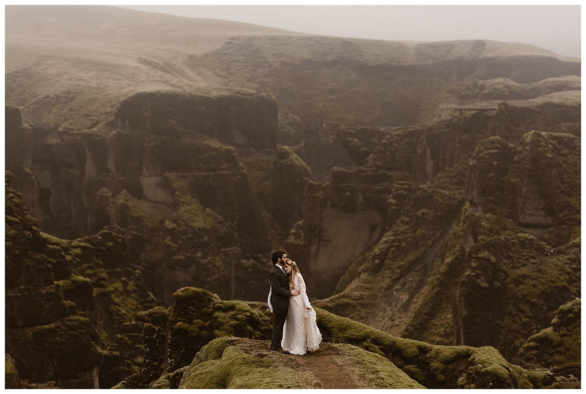 For epic landscapes as varied as they can be, Iceland is an amazing location for any intimate wedding. Fjadrargljufur Canyon, one of the many spots that Julie and Tim chose to celebrate their intimate elopement. Photos by traveling photographer Maddie Mae.