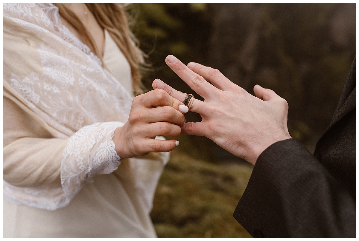 Julie delicately slipped Tim's custom wood ring over his finger, a symbol of her never ending love for him. This intimate Iceland elopement photographed by traveling wedding photographer Maddie Mae.