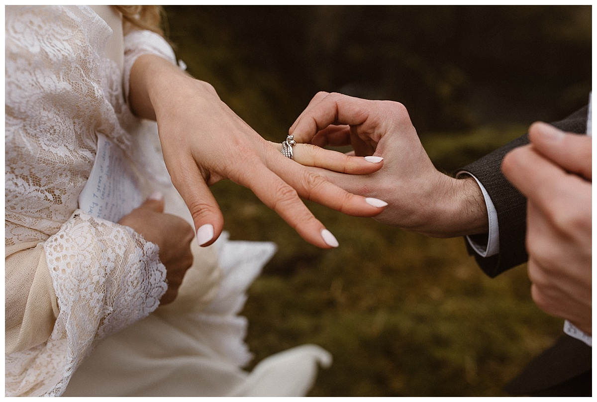 Having found Julie the most perfect vintage style ring, Tim pressed it past her knuckles to show his endless love for her. Their intimate elopement at Fjadrargljufur Canyon captured by wedding photographer Maddie Mae.