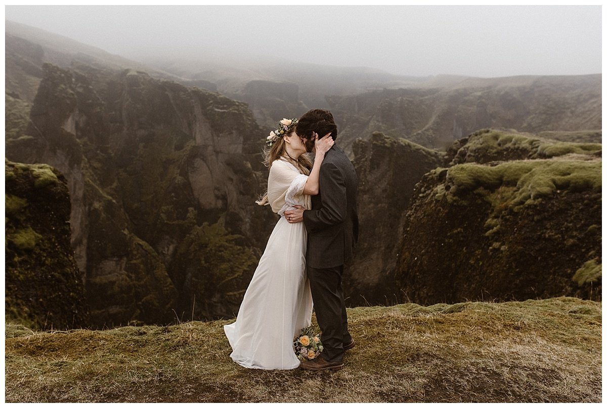 And just like that, high up Fjadrargljufur Canyon, Julie and Tim shared their first kiss as husband and wife. This incredible Iceland elopement was photographed by intimate wedding photographer Maddie Mae.