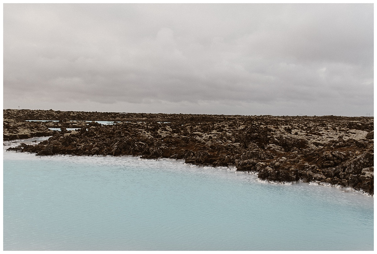 Perhaps one of the most well known locations in Iceland, the Blue Lagoon glows an icy blue surrounded by jagged rocks. Julie and Tim picked it for the last of their epic locations for their intimate elopement. Photos by traveling wedding photographer Maddie Mae.