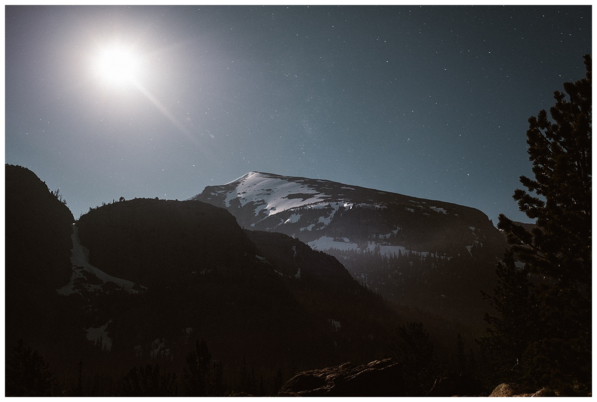 Starting at the trailhead well before dawn, Sarah and Justin began their intimate hiking elopement through Rocky Mountain National Park by the light of the moon. This adventurous elopement photographed by Maddie Mae Photography.
