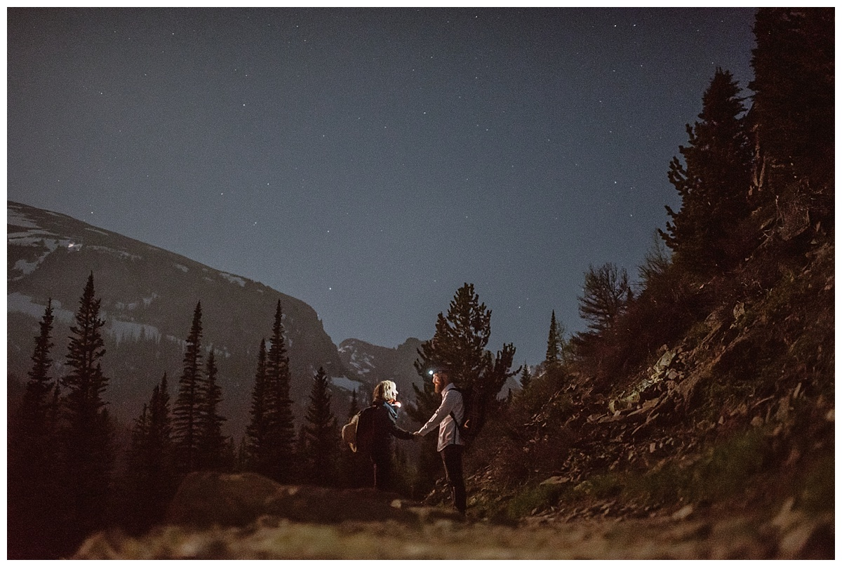 By the light of the stars, headlamps and a flashlight they made their way through the mixed high alpine terrain of Rocky Mountain National Park for their intimate elopement. Photos by traveling wedding photographer Maddie Mae.