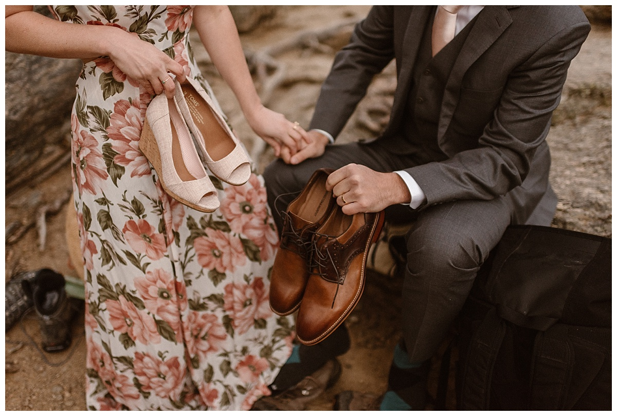 Although they hiked in the wee morning hours, they still managed to bring out their most comfortable formal shoes for just a nod to the traditional wedding on their very non-traditional hiking elopement through Rocky Mountain National Park. Photos by intimate wedding photographer Maddie Mae.