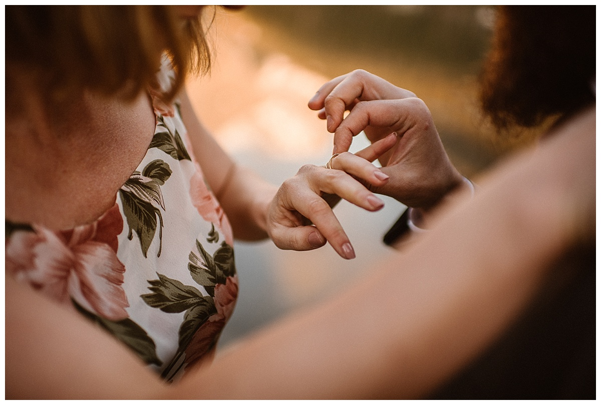 Gently slipping her delicate gold band on her finger, a symbol of his unending love for his stunning mountain bride, their intimate elopement ceremony at Loch Vale was slowly coming to an end. Photos of this high alpine elopement by traveling wedding photographer Maddie Mae.