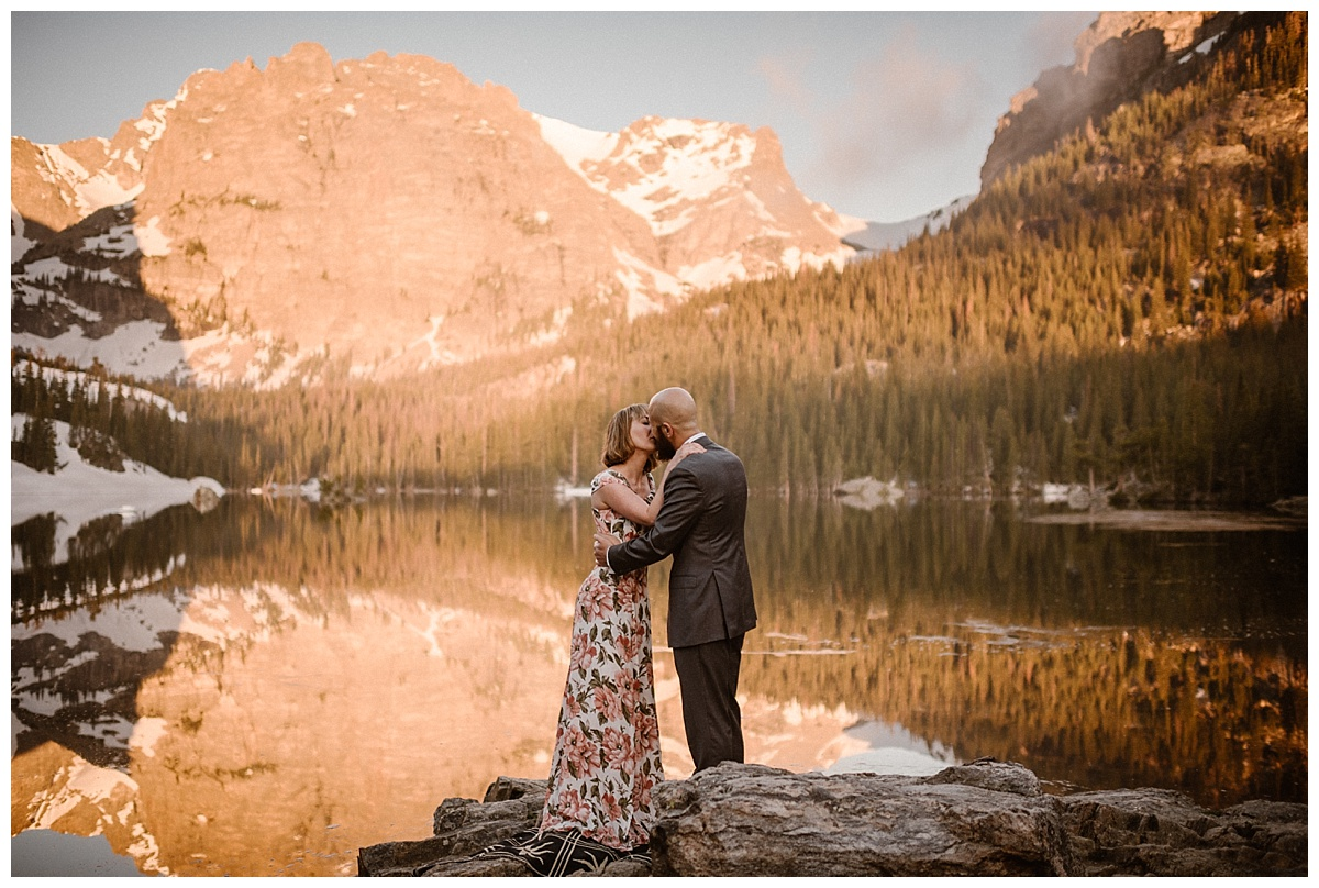 Sealed with a kiss! Sarah and Justin shared their first kiss with the alpine glow beginning to give way to a sunny day in Rocky Mountain National Park. This sunrise Lock Vale elopement captured by intimate wedding photographer Maddie Mae.