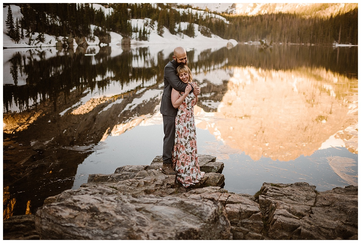 The mountains looked almost pink as they reflected in the water of Loch Vale where Sarah and Justin had just held their intimate RMNP sunrise elopement with only their traveling wedding photographer, Maddie Mae looking on.