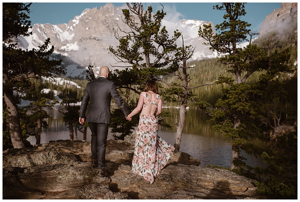 Sarah's floral non-traditional wedding dress made her glow against the spring green back drop of Loch Vale in Rocky Mountain National Park where she and Justin picked for their adventurous intimate elopement. Photos by Colorado native and traveling wedding photographer Maddie Mae.