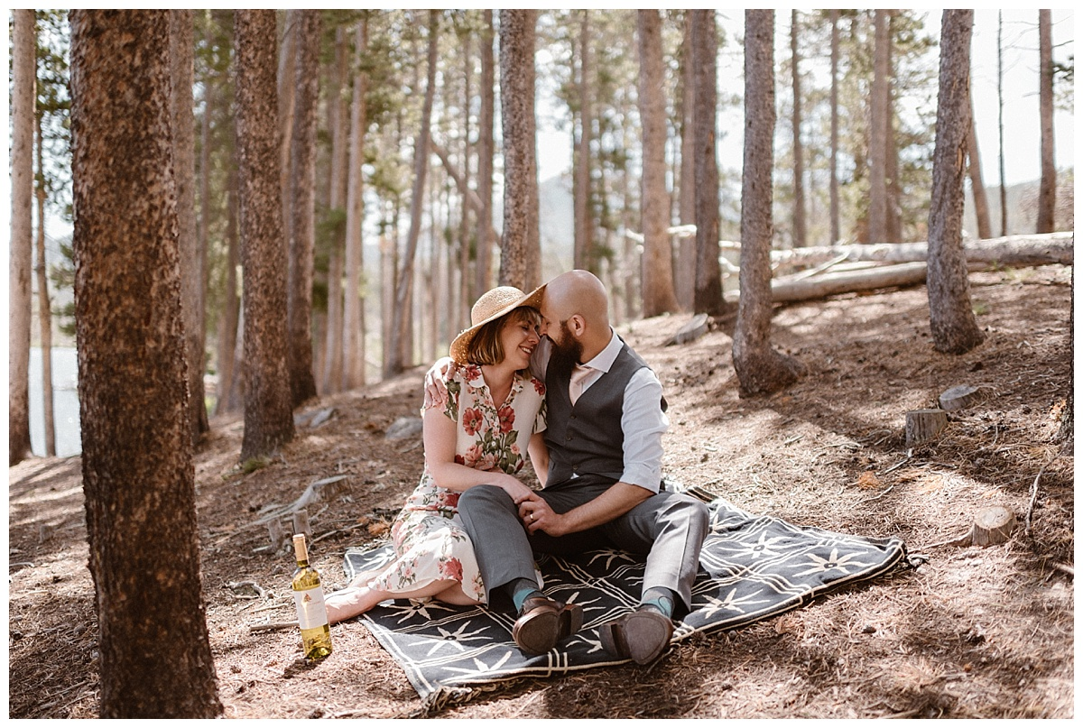 Even packing along a bottle of their favorite white wine, this adventurous and vintage inspired couple stopped in the spotted sunlight at Sprague Lake to enjoy this intimate moment. Their elopement through Rocky Mountain National Park captured by traveling wedding photographer Maddie Mae.
