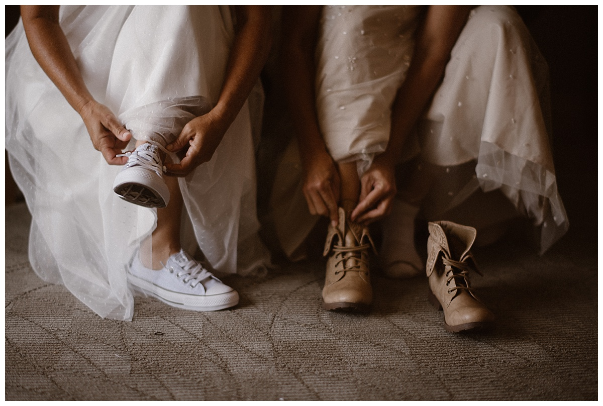 Keeping with their tradition of non-traditional wedding gear, Kari and Karin donned their most comfortable tennis shoes and boots for their adventurous elopement through Tofino BC with their intimate wedding photographer Maddie Mae.