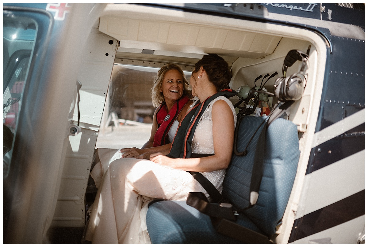 Buckling in to the helicopter, Kari and Karin got ready to take off on the adventure of a life time. Their epic adventure elopement through Tofino BC captured by traveling wedding photographer Maddie Mae.