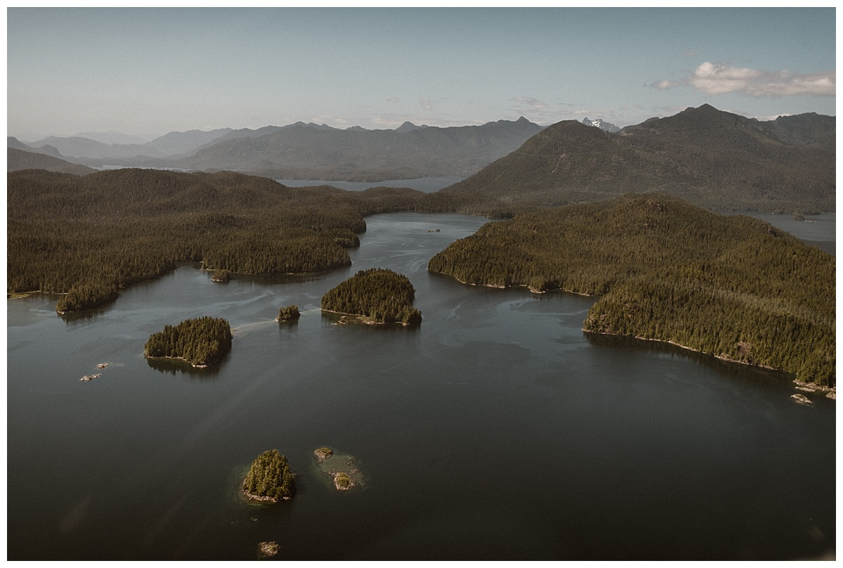 Tofino BC is one of the most stunning views especially from the sky. This adventurous helicopter elopement captured by traveling wedding photographer Maddie Mae.