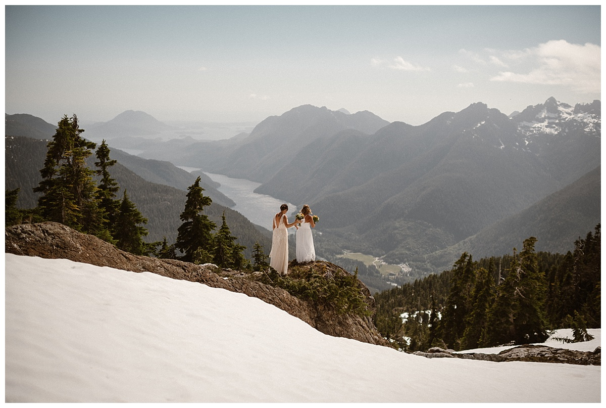They wandered just beyond the snow out to a rocky overlook where they were about to wed. This intimate and adventurous elopement through Tofino BC by helicopter photographed by traveling wedding photographer Maddie Mae.