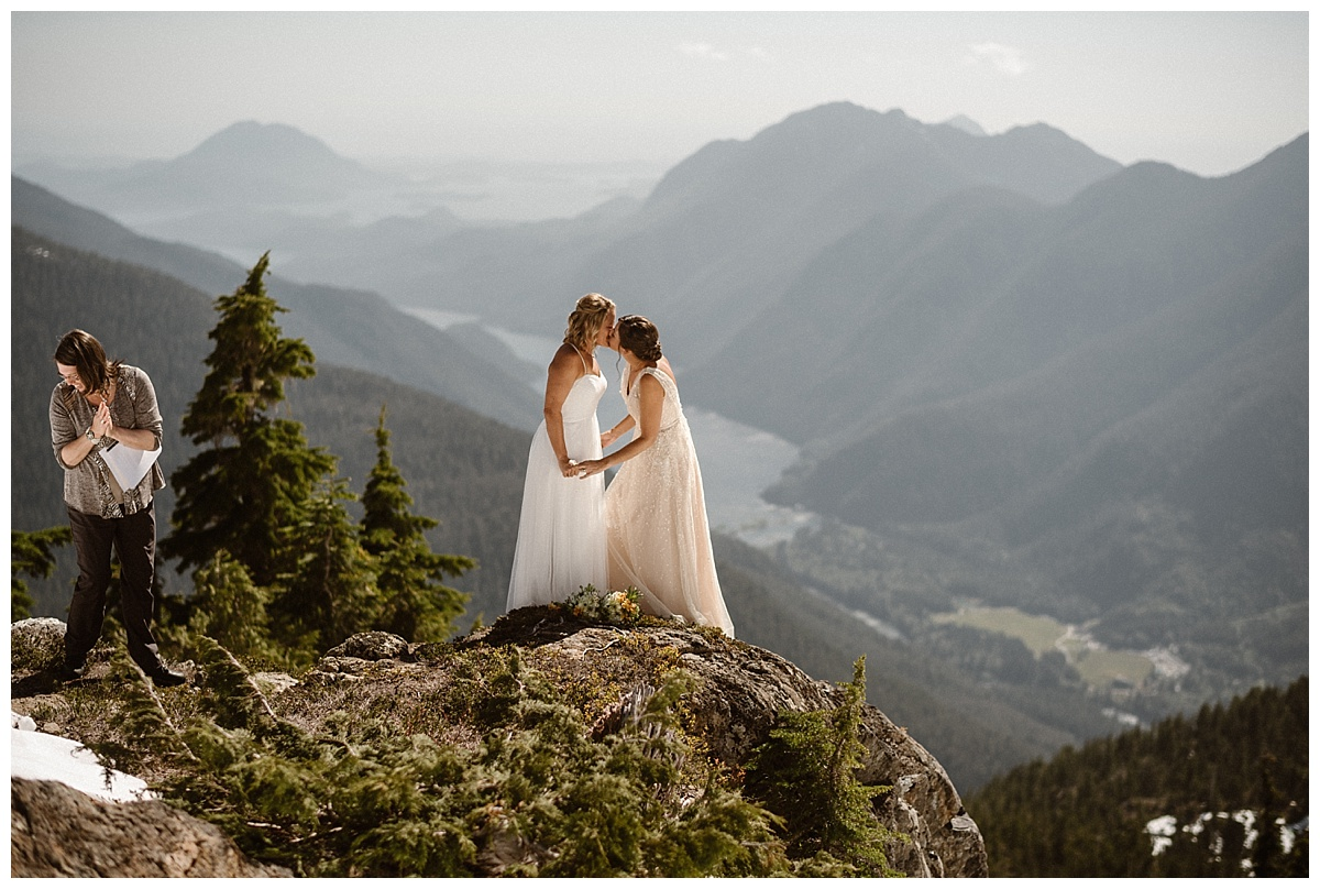 Sealed with a kiss! Kari and Karen shared their first kiss high above Tofino BC surrounded by sunshine and snow. Their adventurous intimate elopement by helicopter captured by traveling wedding photographer Maddie Mae.