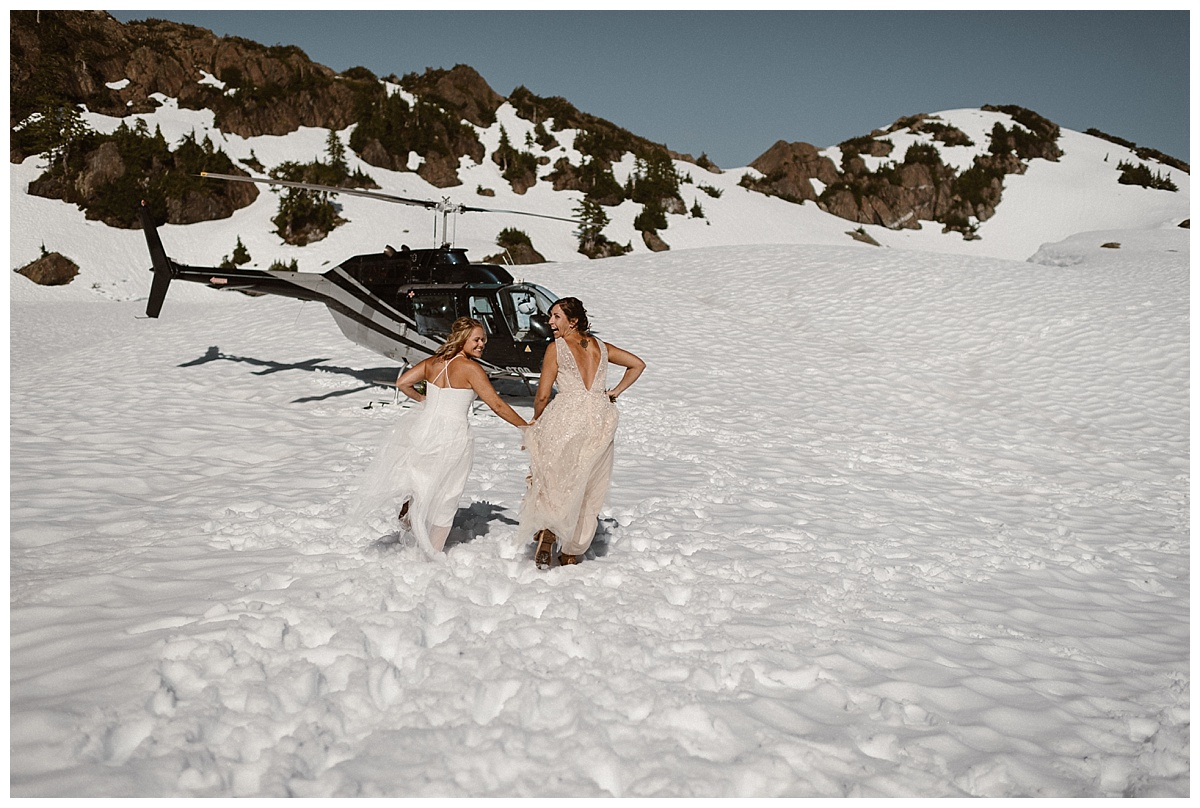 This adventurous helicopter elopement through Tofino BC for two non-traditional brides was photographed by traveling intimate wedding photographer Maddie Mae.