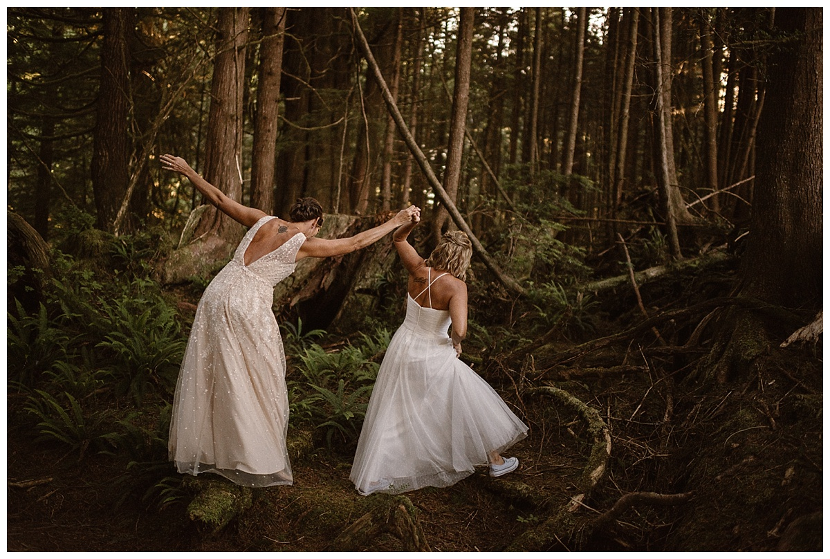 Kari and Karin stumbled and hopped over branches and moss patches as they went deeper into the forest. Their adventurous elopement through Tofino BC was photographed by traveling intimate wedding photographer Maddie Mae.