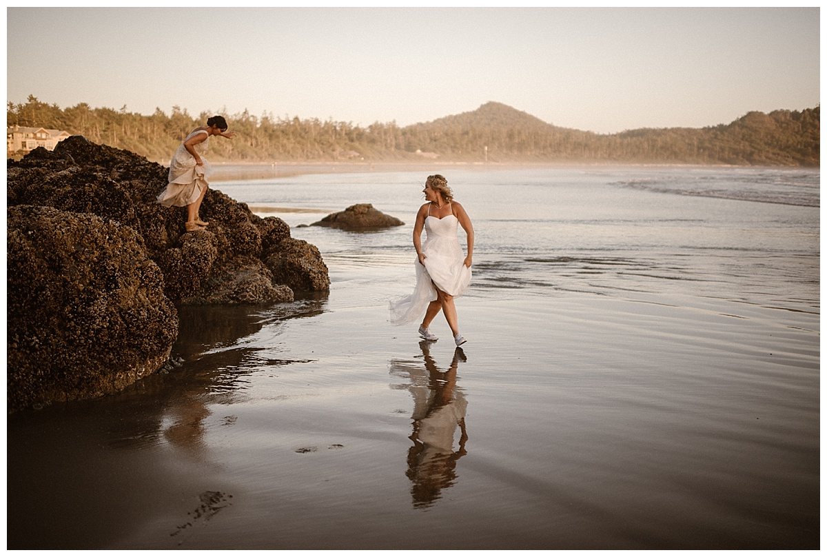 The climbed down from the forest onto the rising tide of Tofino beach. Photos of this helicopter elopement through BC Canada by traveling wedding photographer Maddie Mae.