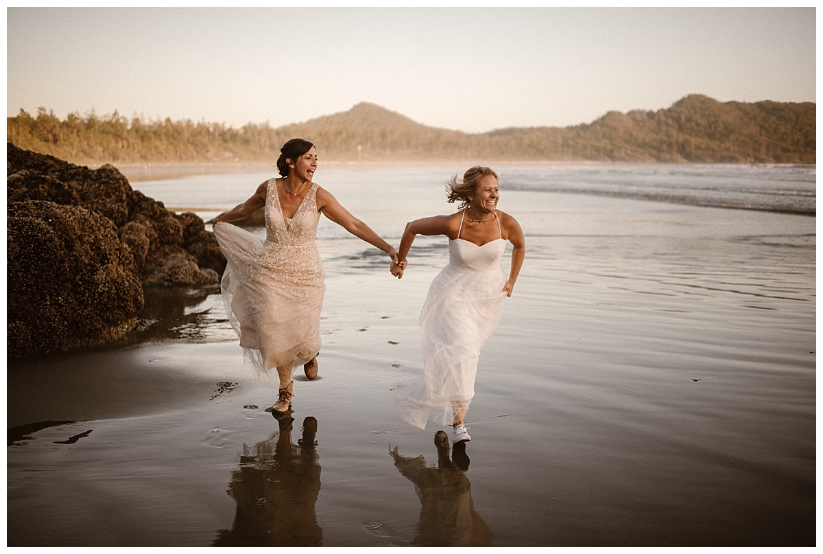 They ran onwards down the beach as the sun began to set in Tofino BC. Their epic adventurous elopement captured by traveling wedding photographer Maddie Mae.