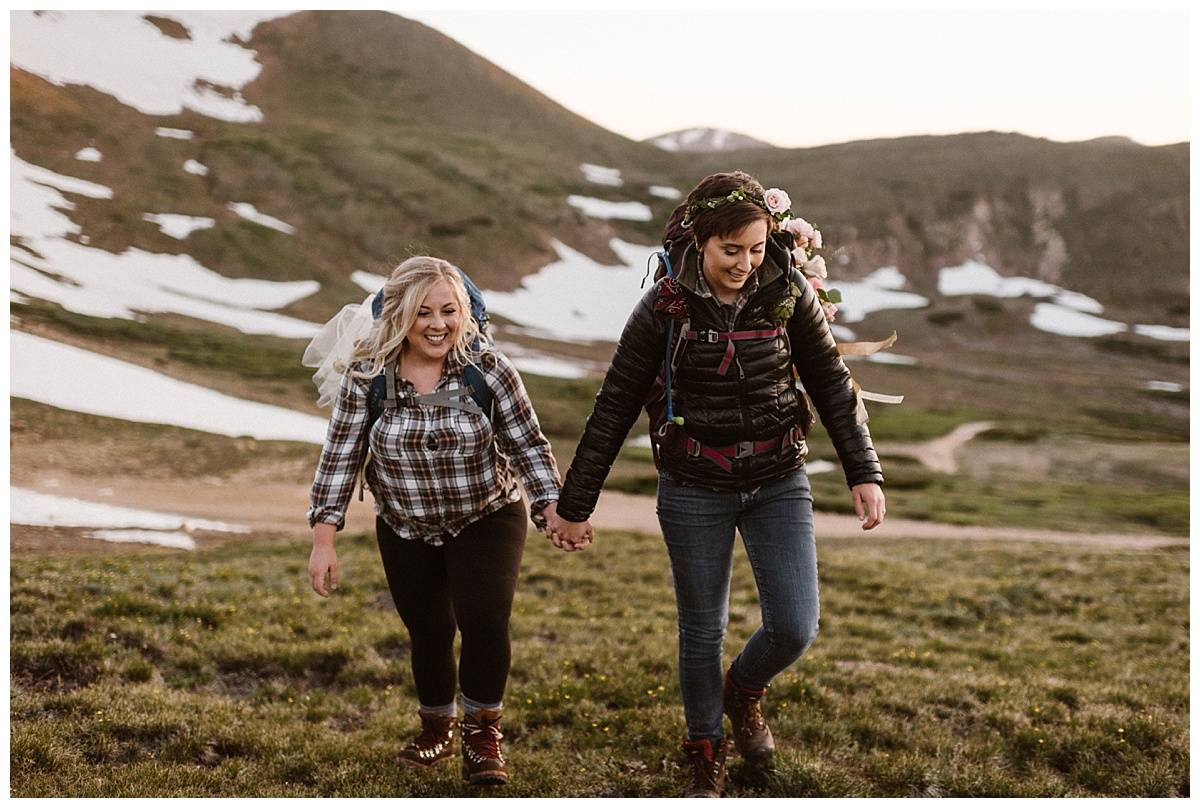 These beautiful brides hiked their way up Jonas Pass as the sun began to rise over the San Juan mountains on the morning of their intimate elopement with traveling wedding photographer Maddie Mae.
