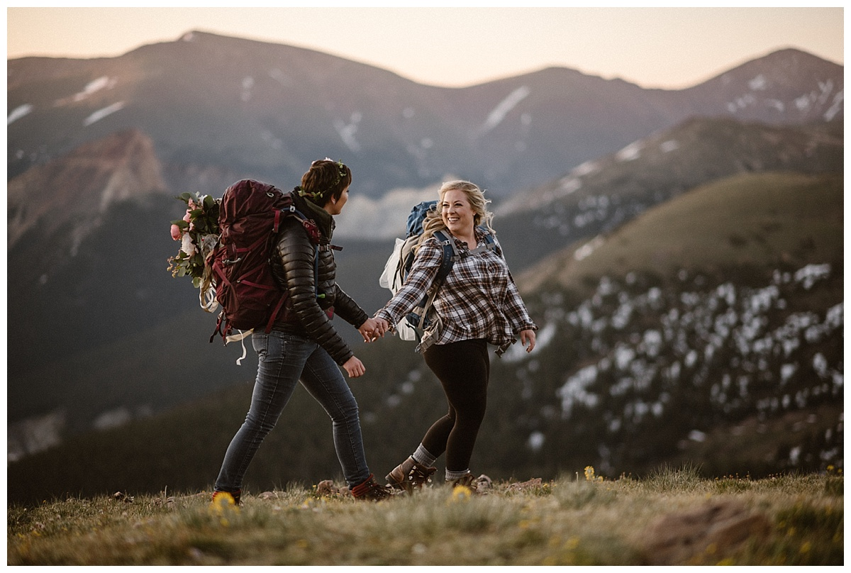 As they reached the top of the Jonas Pass, these stunning brides flashed each other a quick smile knowing their intimate sunrise elope ceremony was soon to commence. Their only witness their traveling wedding photographer, Maddie Mae thanks to Colorado's self solemnization laws