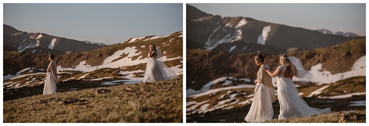 Dona waited watching the sun rise over the San Juan mountains as her stunning bride wandered through the high alpine terrain towards her. Their intimate first look up Jonas Pass captured by traveling photographer Maddie Mae.