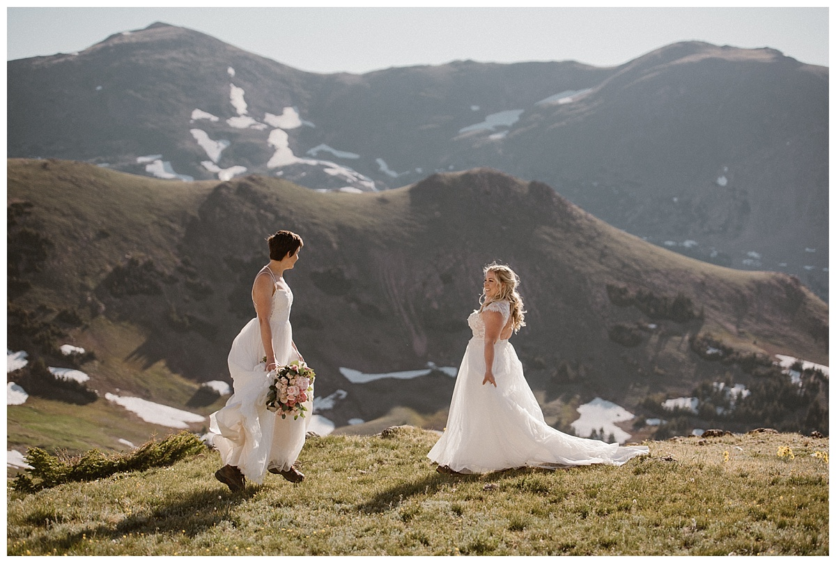 Skipping in the sunny Colorado mountains, Dona and Malisa celebrated their intimate elopement up Jonas Pass by hiking and enjoying the privacy of the high alpine terrain. Their sunrise Berthoud Pass elopement captured by intimate wedding photographer Maddie Mae.