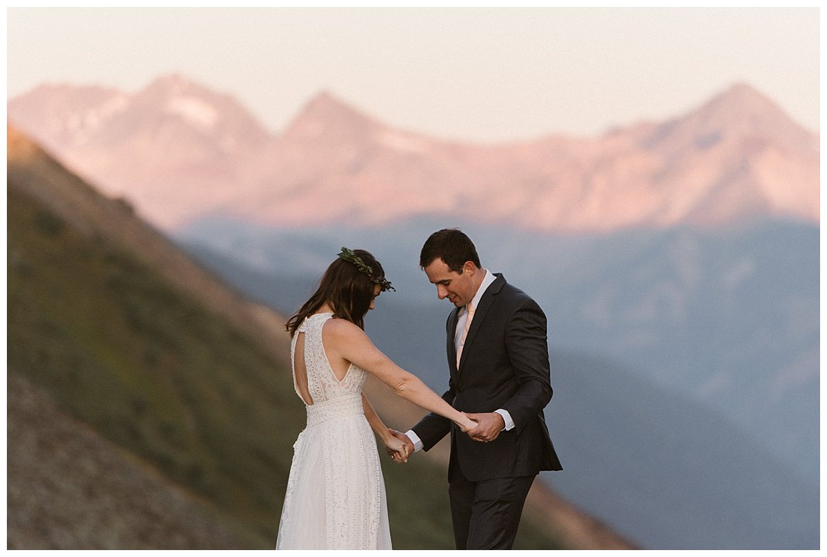 Clint looked his stunning mountain bride up and down again. He could hardly believe that he was about to marry this amazing woman in an intimate wedding ceremony in Telluride with the San Juan Mountains as their backdrop. Photos of this private first look pre-ceremony by traveling elopement photographer Maddie Mae.