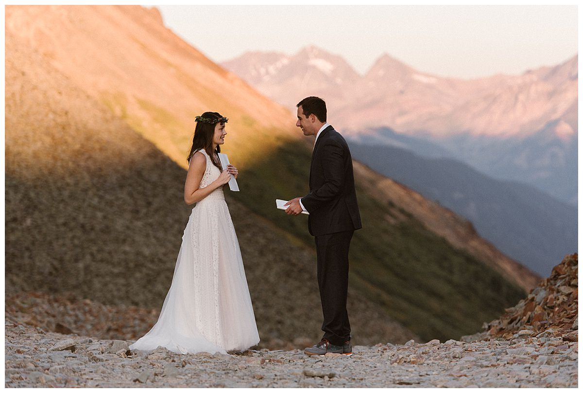 As Clint went to give Joy her surprise wedding gift, she stopped him short so that she too could surprise him with a thoughtful pre-wedding token. Photos of this adventurous sunrise first look in the San Juan Mountains near Telluride by intimate elopement photographer Maddie Mae.