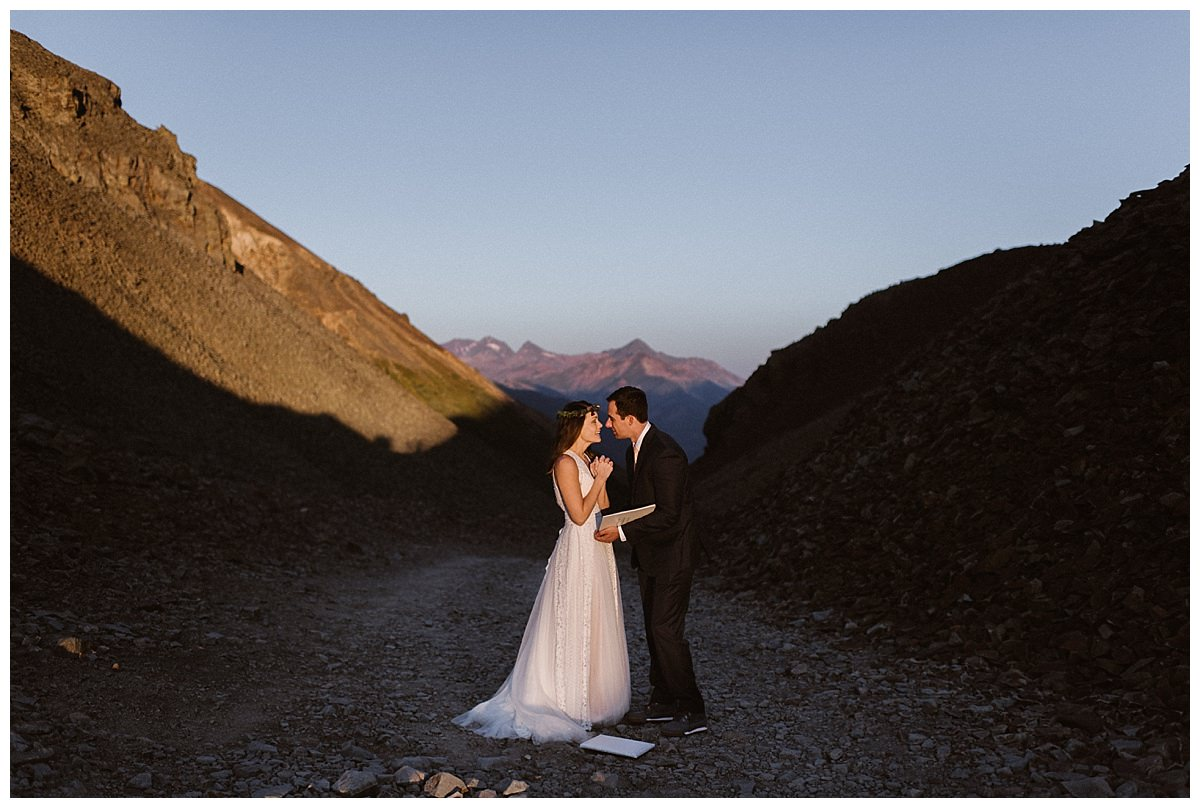 The peaked over the mountains lighting up this adventurous couple as they exchanged wedding gifts after an private first look up Ophir Pass in the San Juan Mountains. Photos of this epic and romantic wedding by traveling elopement photographer Maddie Mae.