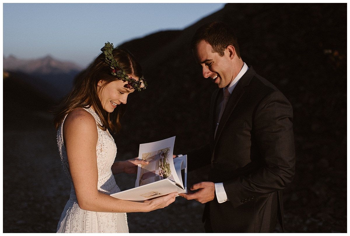 As Joy flipped through the pages of the photo book that Clint had just given to her as an intimate wedding gift she couldn't help but giggle as she relived all their previous adventures over again. This intimate first look and private gift exchange pre-wedding ceremony was photographed by intimate elopement photographer Maddie Mae.