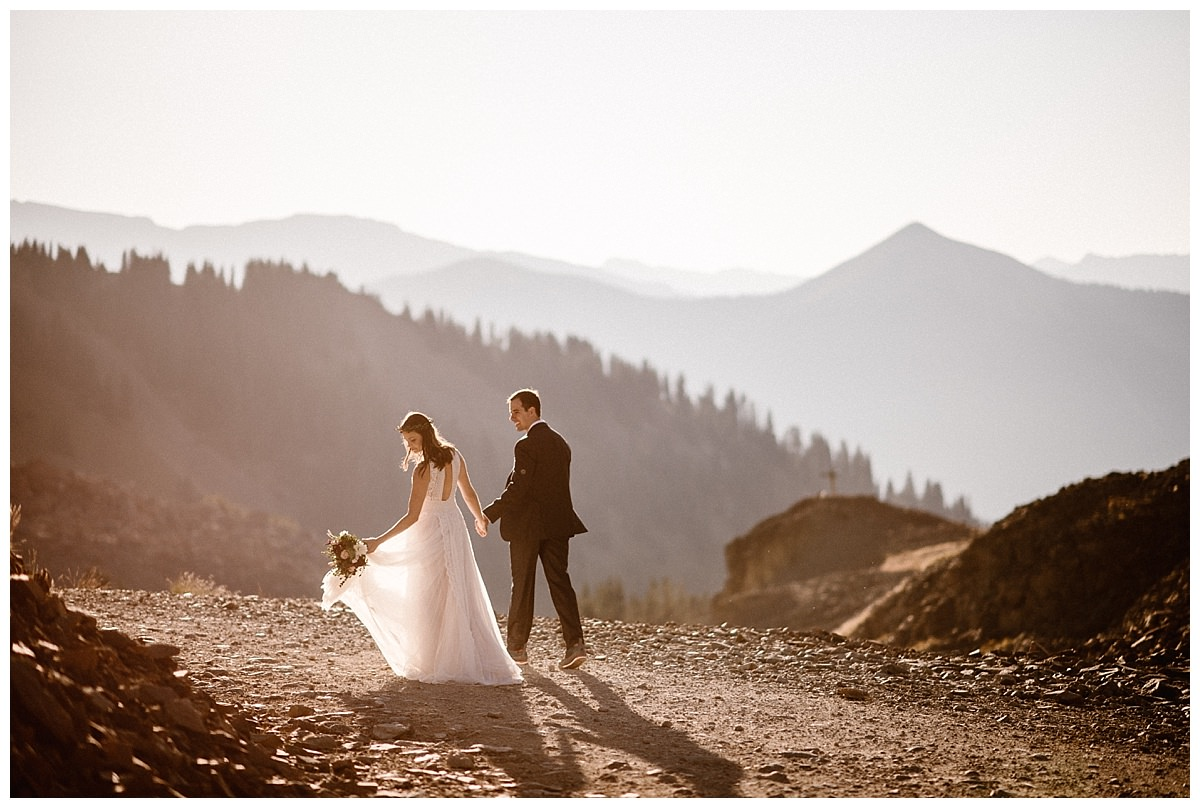 They paused their Jeep 4x4 so they could walk in the pink sunlight to look at the views of Telluride below them. This intimate sunrise first look up Ophir Pass was captured by adventurous elopement photographer Maddie Mae.