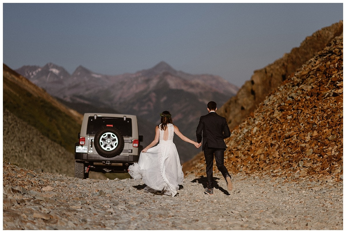 They made their way back to their Jeep 4x4 so they could continue down Ophir Pass with their intimate wedding photographer Maddie Mae. This adventurous couple opted for a private sunrise first look before their intimate wedding ceremony at Telluride Ski Resort.