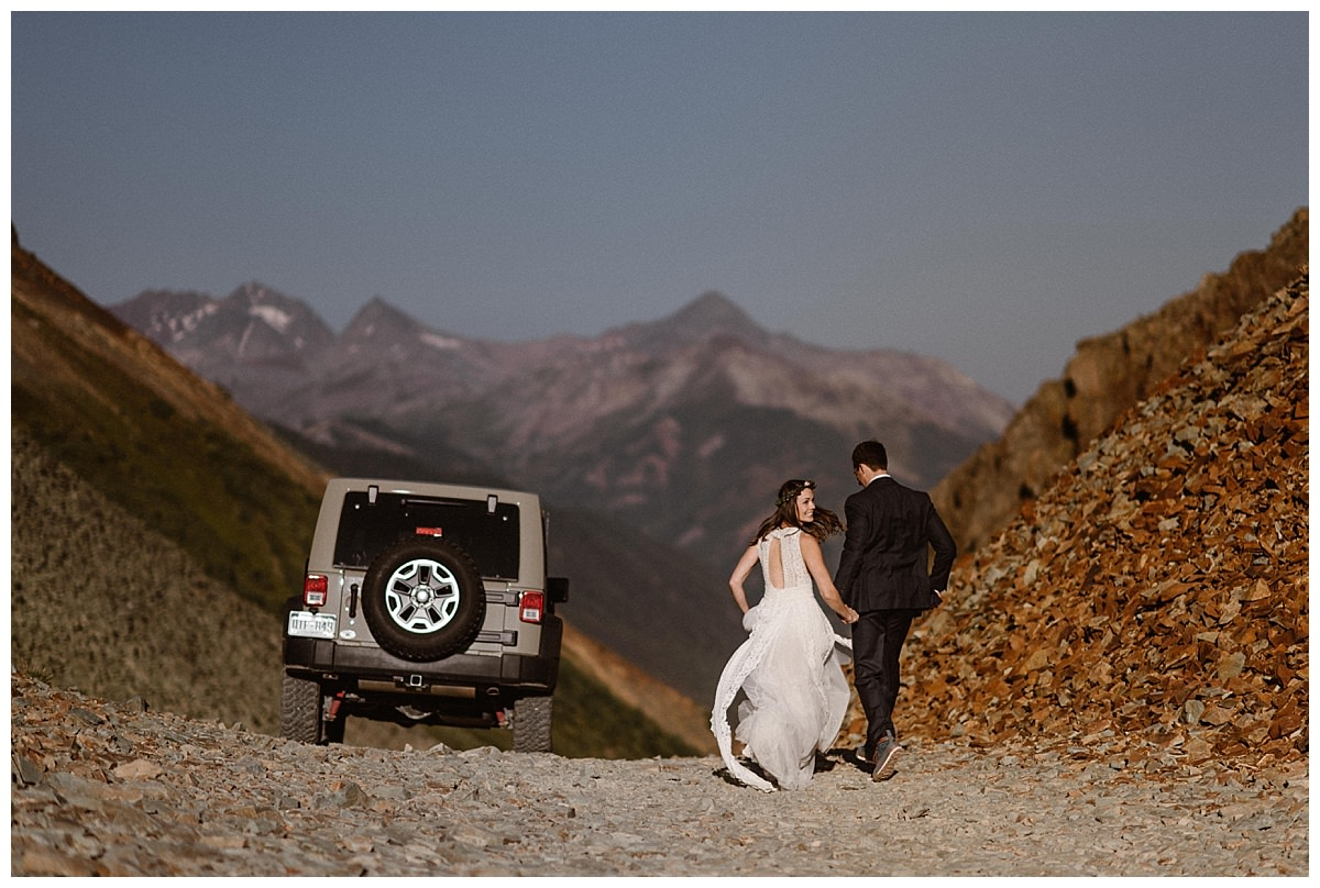 Looking back to take in all that had just happened to her, Joy and Clint ran back to their rented Jeep 4x4 so they could continue on Ophir Pass on their adventurous sunrise first look in the San Juan Mountains with only their intimate wedding photographer Maddie Mae in tow.