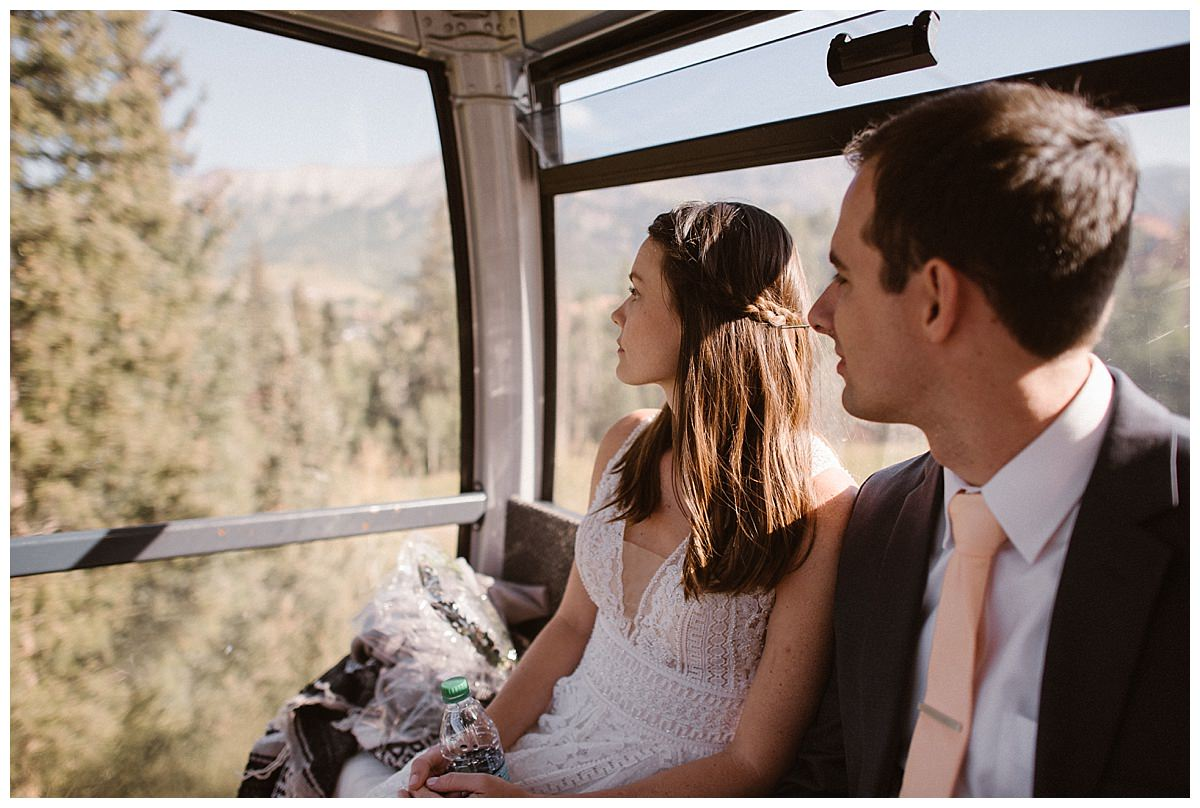 They looked out from the windows of the gondola that would take them up to their intimate wedding ceremony at Telluride Ski Resort. The sun shone brightly and the San Juan Mountains even seemed clearer than normal. Photos of this adventurous wedding around Telluride, Colorado by intimate elopement photographer Maddie Mae.