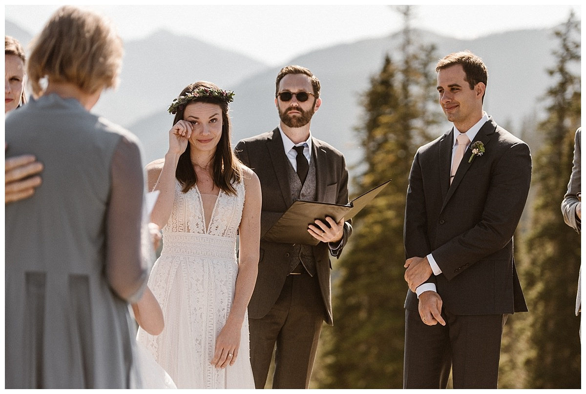 Joy's mother began with some words of advice and encouragement for this soon to be wed couple. This romantic and emotional intimate wedding ceremony at Telluride Ski Resort was captured on this warm summer day by intimate elopement photographer Maddie Mae.