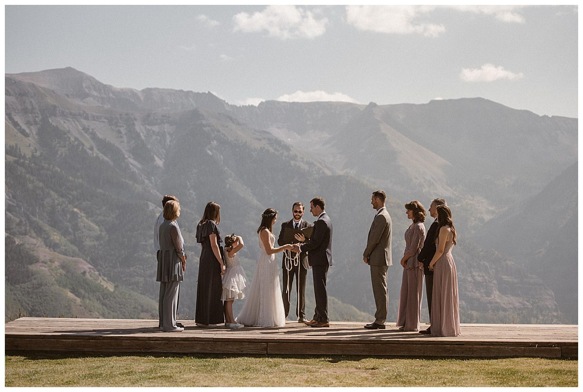 """With their hands literally tied together and their families looking on, Joy and Clint said their final """"I do's"""" with the San Juan Mountains as their backdrop at the Telluride Ski Resort. This romantic and non traditional wedding was photographed by intimate elopement photographer Maddie Mae."""