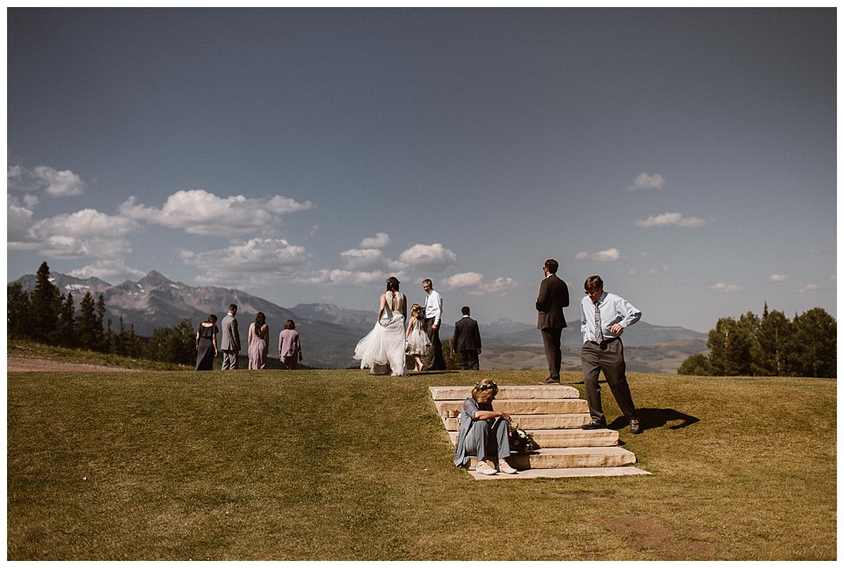 After their intimate wedding ceremony their bridal party took in the sights of the San Juan Mountains from the open grassy field of the Telluride Ski Resort. Joy and Clint were about to sneak off with their traveling elopement photographer Maddie Mae for some intimate portraits near Bridal Veil Falls.
