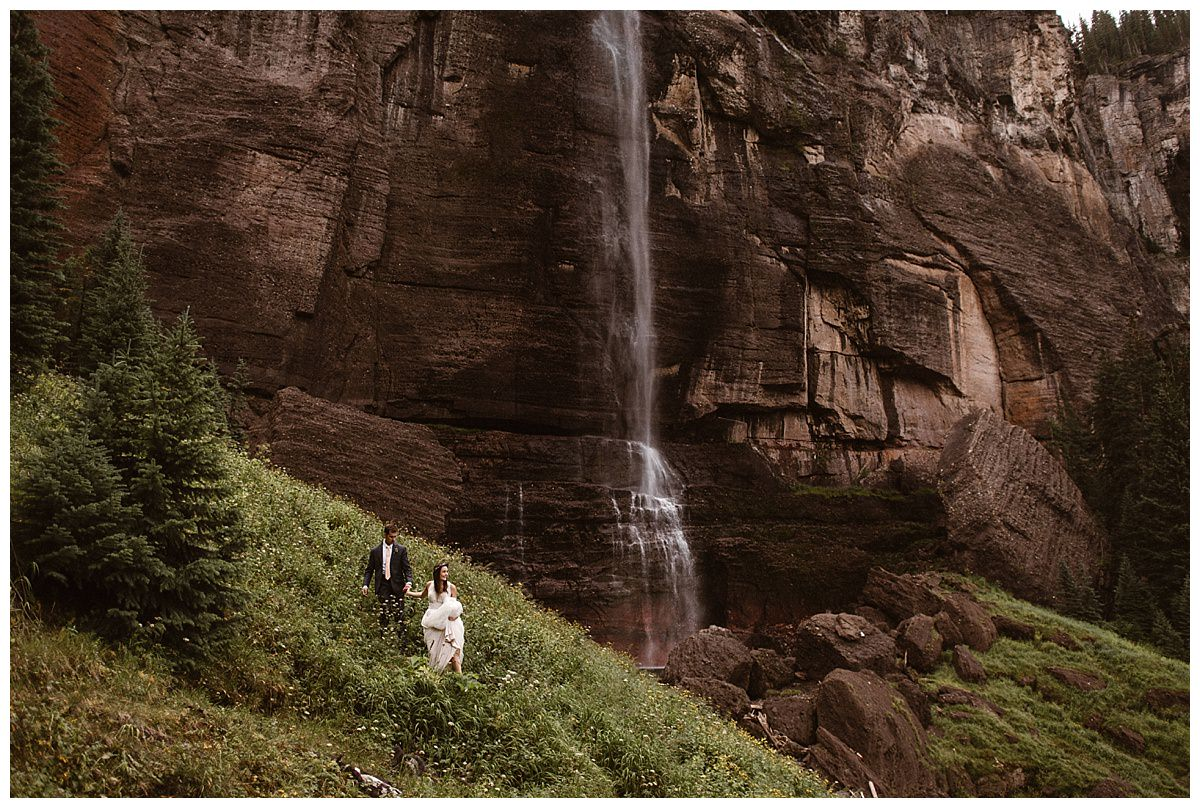 Joy and Clint wandered their way around Bridal Veil Falls where they snuck off to for some intimate wedding portraits with their traveling elopement photographer Maddie Mae. This adventurous couple celebrated their wedding with an epic Jeep 4x4 sunrise excursion up Ophir Pass, followed by an small wedding ceremony with only their closest family and friends in attendance at the Telluride Ski Resort in Colorado.