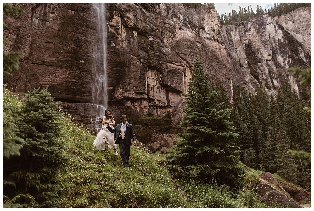 As their adventurous day wrapped up, Clint lead his wife down the grassy hillside from Bridal Veil Falls back to Telluride where the would continue their wedding celebrations with their closest friends and family. Photos of this romantic and private wedding by intimate elopement photographer Maddie Mae