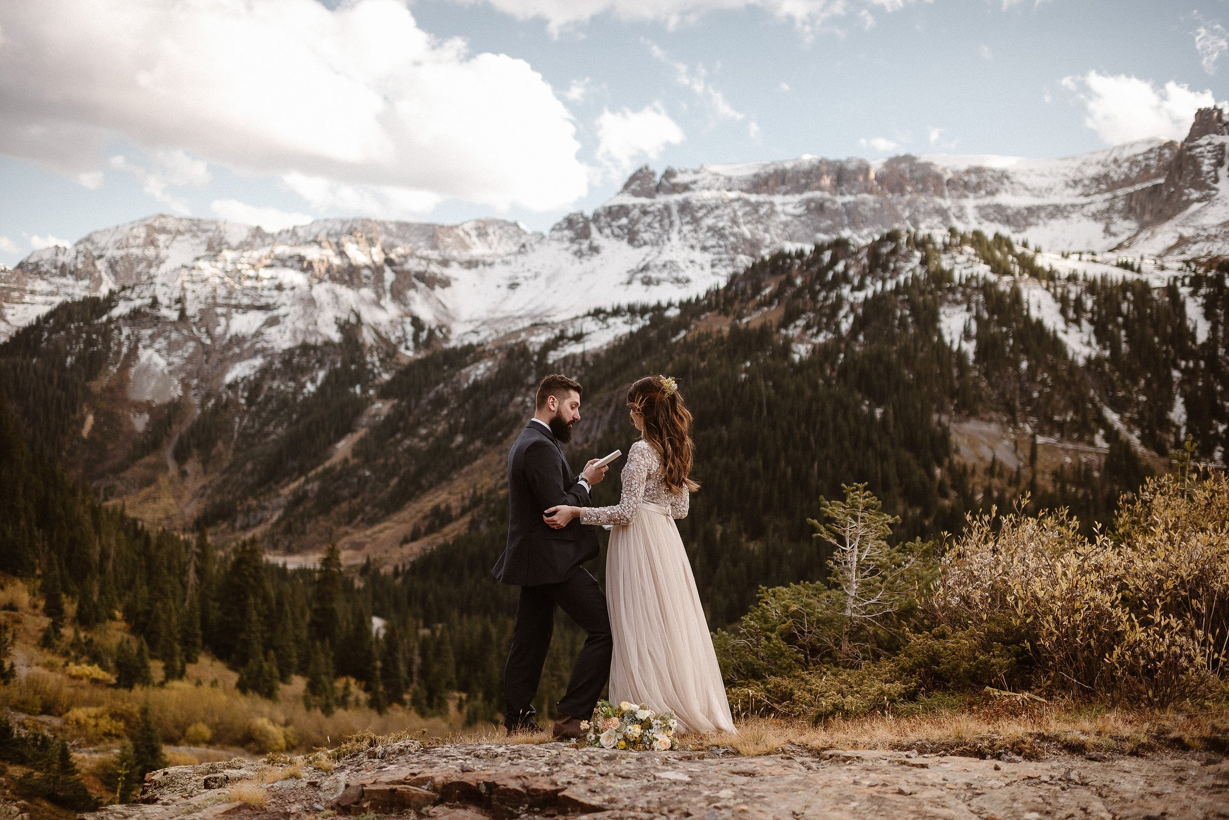 Dan told his bride of all the promises he would keep, the ways that he would continue to love and honor her in his intimate vows. He professed all these things high above the world in the San Juan Mountains near Ouray, Colorado where he and his bride had opted for adventure and hiked to a private location in Yankee Boy Basin with only their intimate wedding photographer Maddie Mae for their elopement.