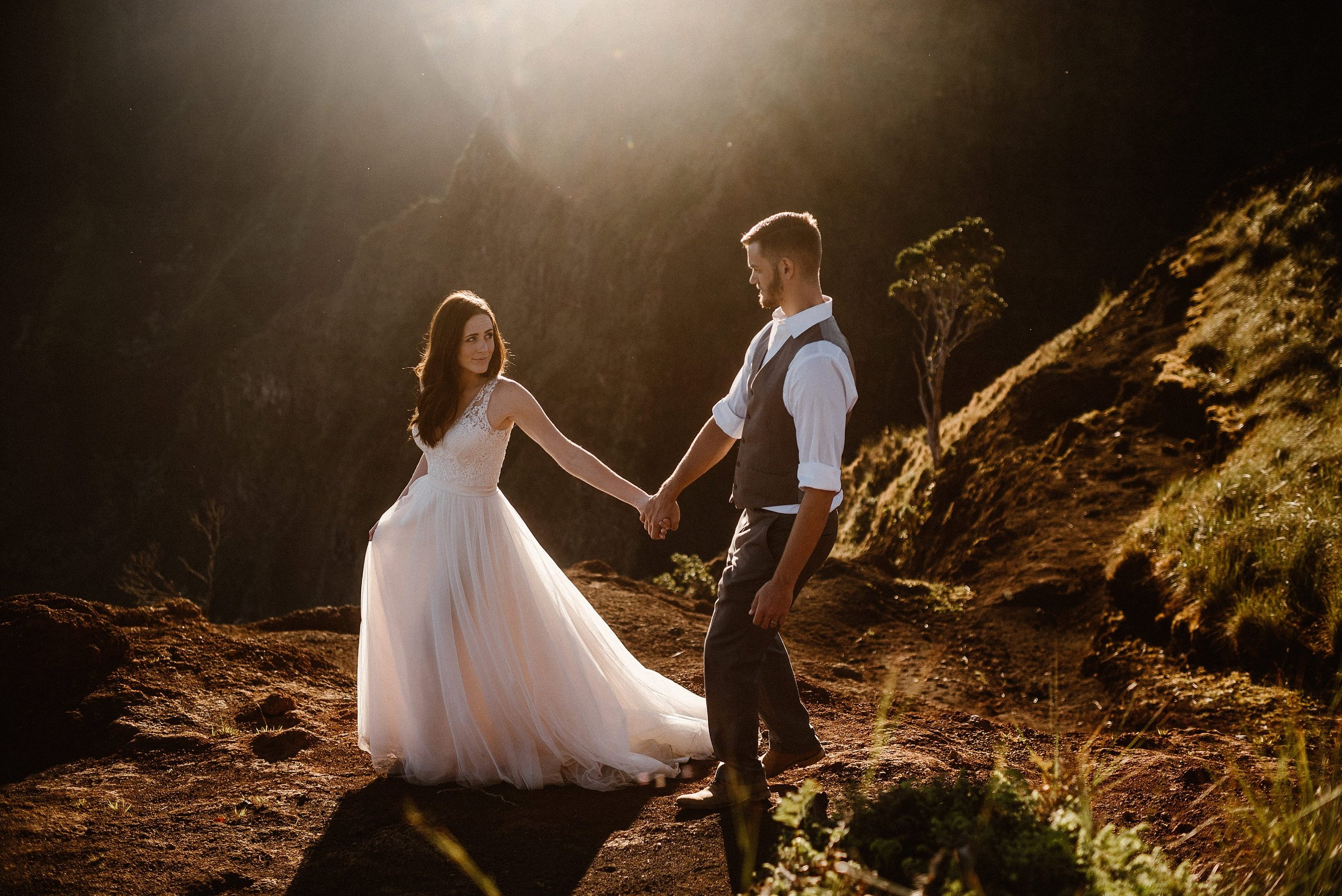 With the Hawaiian sun behind them, causing them to glow Kourtney and Chris hiked down the Kalepa Ridge Trail in Kauai to a private location to say their intimate elopement vows privately with only their traveling adventure wedding photographer Maddie Mae as their witness.