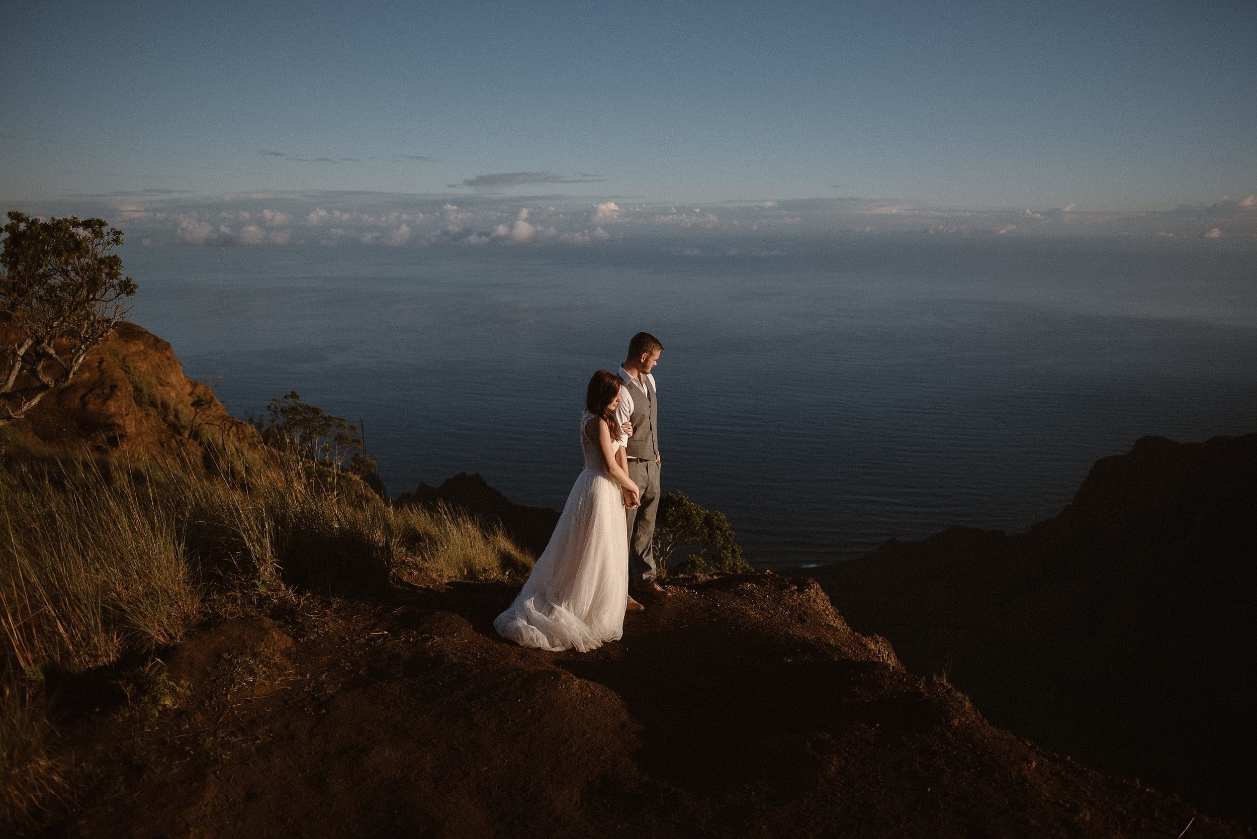 They paused for one last look over the calm ocean, the afternoon sunlight on their faces. Kourtney and Chris threw tradition to the wind and hiked up to Kalalaua Lookout in Kauai with only their intimate elopement photographer Maddie Mae to snap their most private moments of their ceremony.
