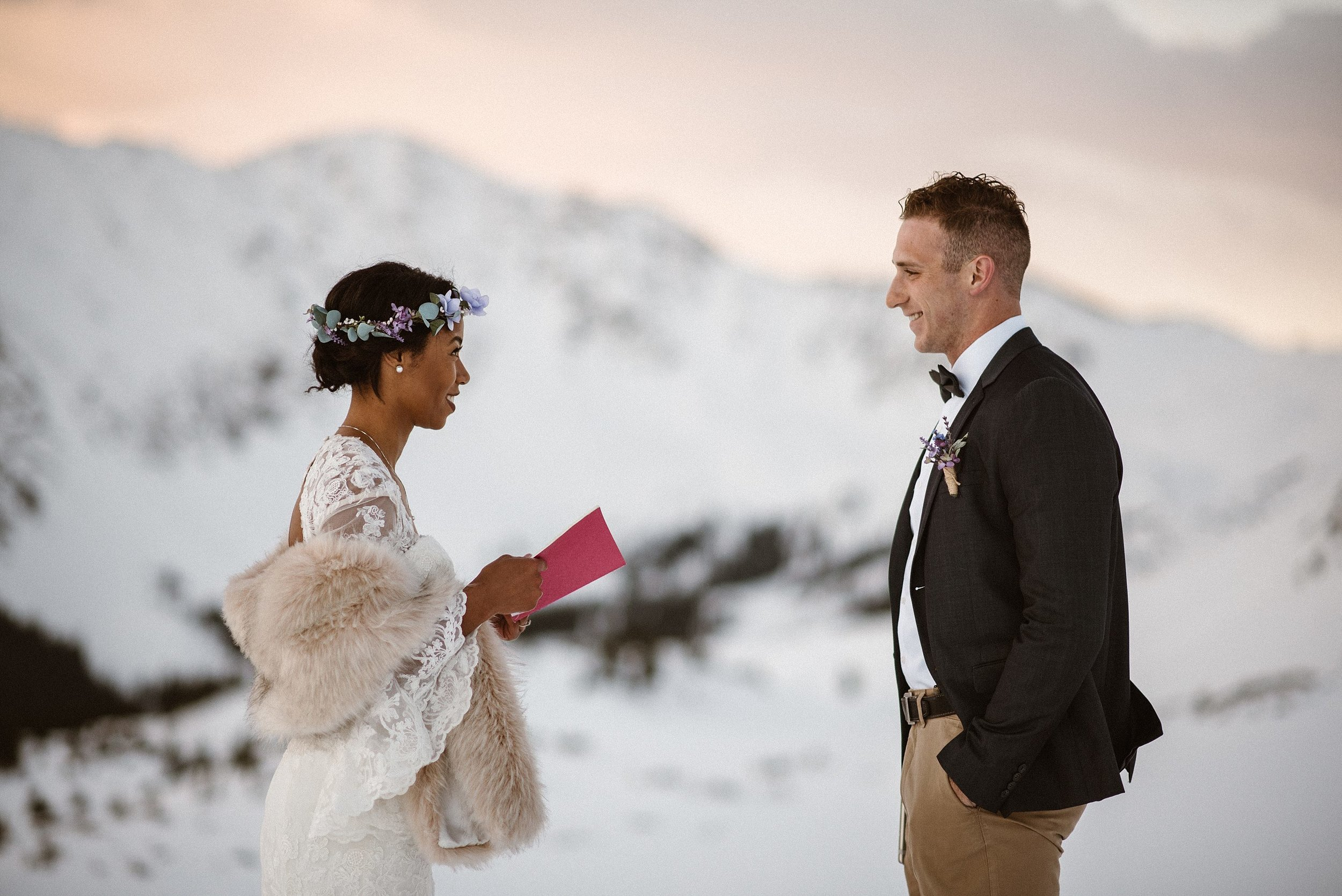 Giving him a smile worth a thousand words, Mikayla and Jared had come to the perfect spot up Loveland Pass where they would say their vows. The only witness to their elopement, their intimate wedding photographer Maddie Mae.