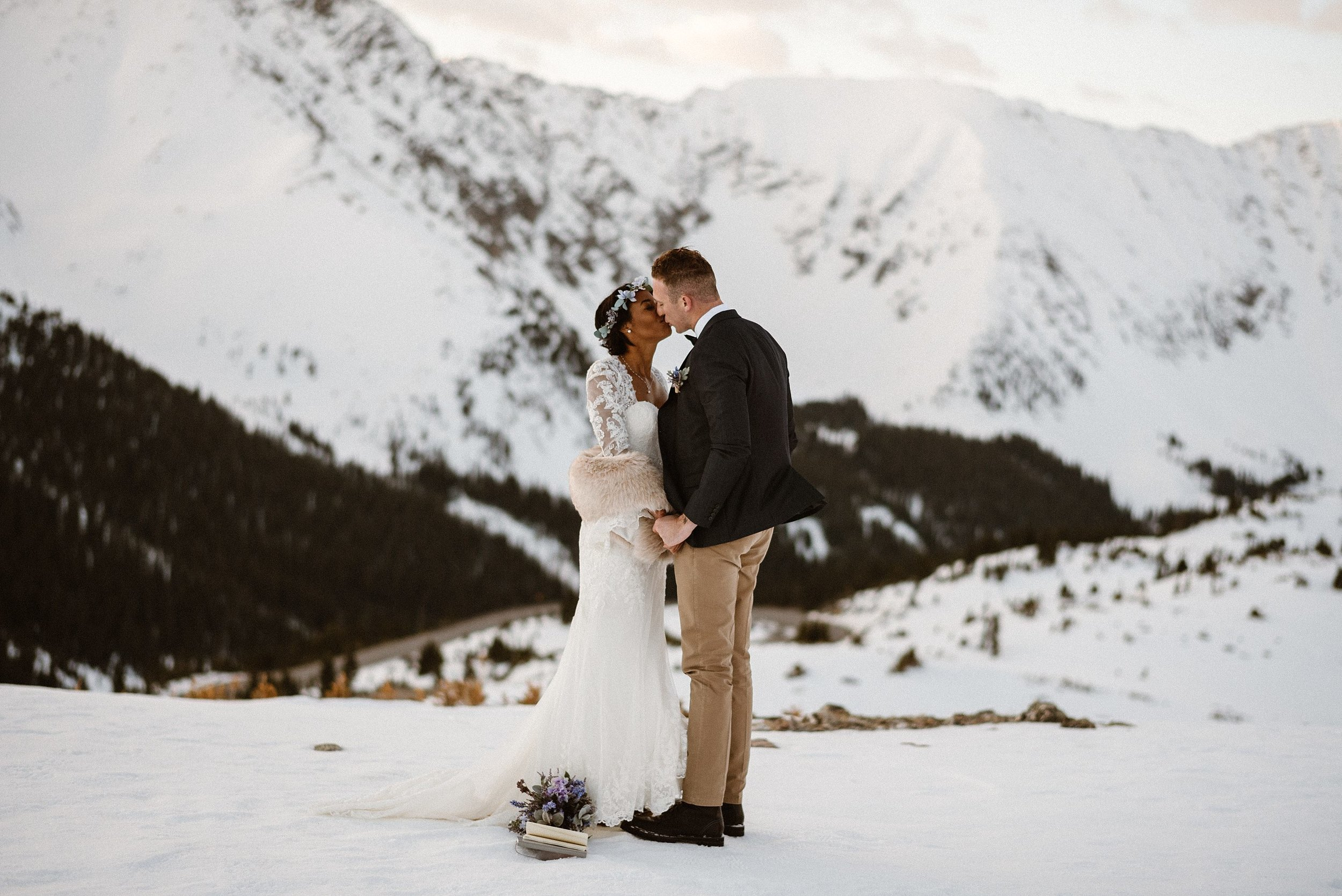 Sharing their first kiss as husband and wife high above Loveland Pass lakes, Mikayla and Jared were just about to start on their adventurous hiking elopement all through Silverthorne and Breckinridge, Colorado. Photographed by intimate wedding photographer Maddie Mae.