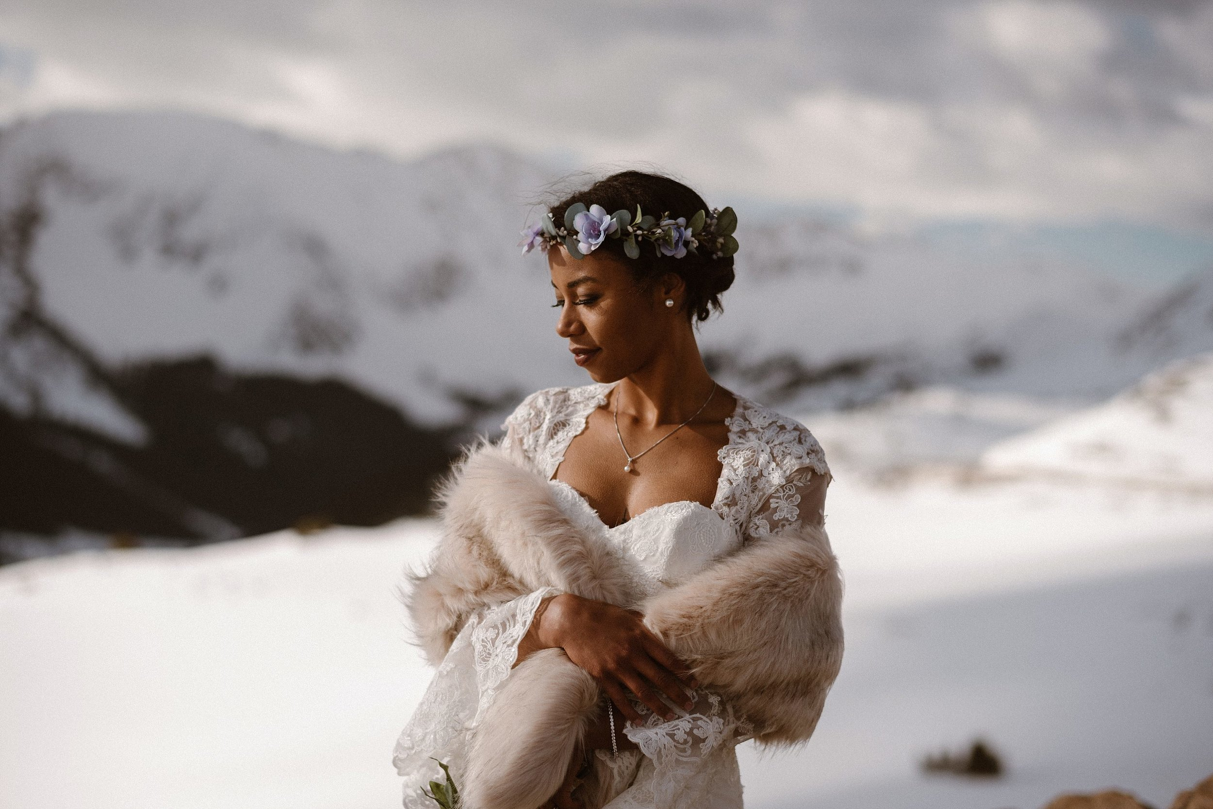 With her lilac flower crown, fitted lace wedding dress and vintage fur, Mikayla was truly a vision from a winter fairytale - a snowy angelic bride. Photos of this intimate Colorado elopement captured by Maddie Mae Photography.