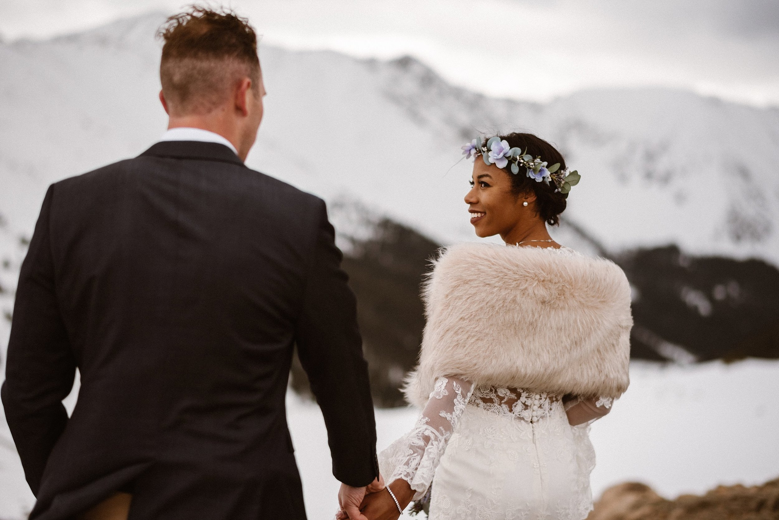Trekking higher into the Rocky Mountains as the sun shone down upon them like a natural spotlight. This vintage styled intimate elopement captured by traveling wedding photographer Maddie Mae.