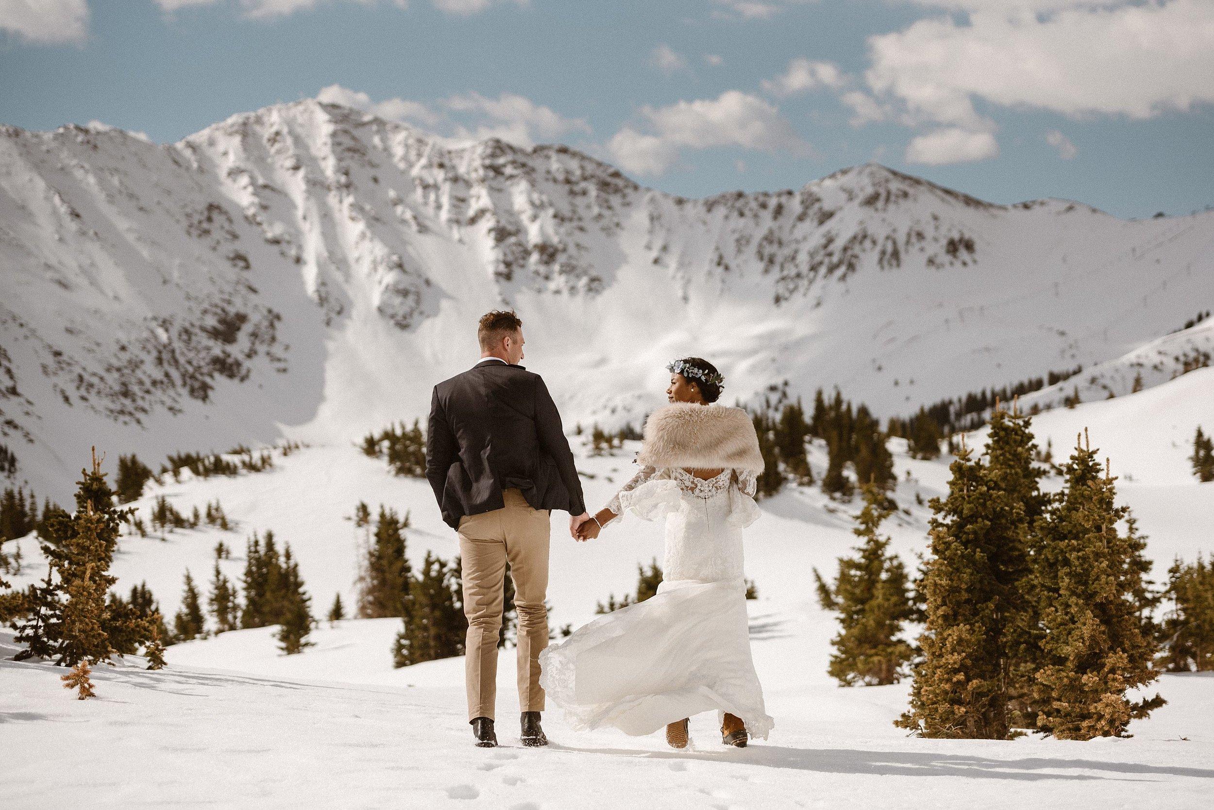 Winter-wedding-Snowy-wedding-winter-elopement-snowy-elopement-Loveland-Pass-wedding-Loveland-Pass-elopement-Arapahoe-Basin-wedding-Arapahoe-Basin-elopement-Keystone-wedding-Keystone-elopement-Breckenridge-wedding-Breckenridge-elopement-Silverthorne-wedding-Silverthorne-elopement-Dillon-wedding-Dillion-elopement-Dillon-Reservoir-wedding-Sapphire-Point-wedding-Sapphire-Point-elopement-Dillon-Reservoir-elopement-Sapphire-Point-Overlook-elopement-Sapphire-Point-Overlook-wedding-Montgomery-Reservoir-wedding-Hoosier-Pass-wedding-Montgomery-Reservoir-elopement-Hoosier-Pass-elopement-maddie-mae-maddie-mae-photography-colorado-elopement-elopement-coloraodo-intimate-elopement-colorado-mountains-colorado-mountain-wedding-colorado-mountain-elopement-intimate-wedding-ceremony-mountain-wedding-ceremony-colorado-mountain-wedding-ceremony-fur-stole-wedding-fur-elope-colorado-elope-in-colorado-adventure-wedding-adventure-wedding-photography-intimate-wedding-photographer-intimate-wedding-photography-intimate-elopement-photography-intimate-elopement-photographer-traveling-elopement-photographer-traveling-elopement-photography-colorado-elopement-locations-harsh-sun-sunny-mountain-elopement-sunrise-elopement-adventure-traveling-elopement-photography
