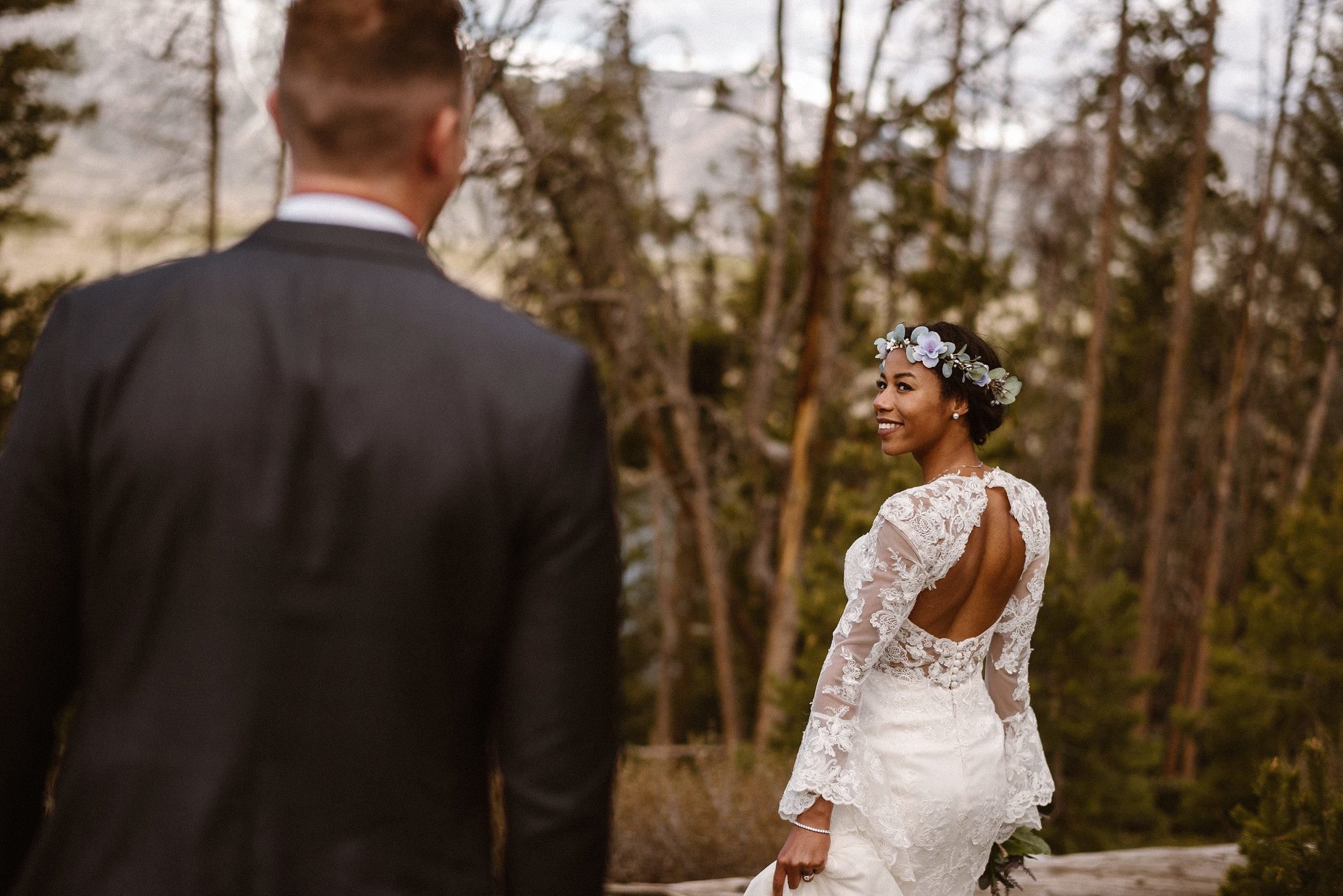Hiking down to Dillon reservoir, Jared and Mikayla meandered their way through old fallen forests with the snow capped Rocky Mountains off in the distance. Photos of this intimate adventurous elopement by traveling wedding photographer Maddie Mae.